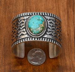 Navajo heavy-silver cuff with single turquoise stone by Elvira Bill.