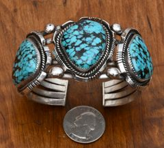 Dead-pawn Navajo Sterling triplet cuff with spider web turquoise.