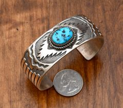 Dead-pawn Navajo Sterling cuff with a single Sleeping Beauty turquoise stone.