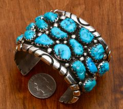 Dead-pawn Navajo Sterling cuff with 17 Sleeping Beauty turquoise stones.