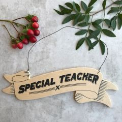 East of India Special Teacher Sign
