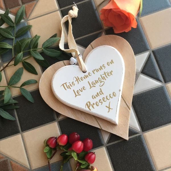 This Home Runs On Love, Laughter And Prosecco Double Hanging Heart Sign