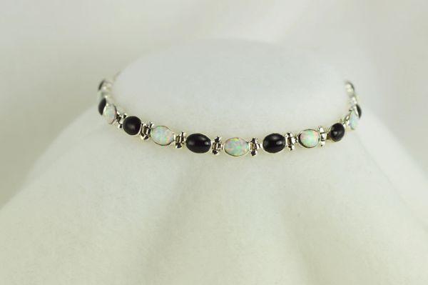 "Sterling silver black onyx and white opal oval 7.5"" link bracelet. B025"