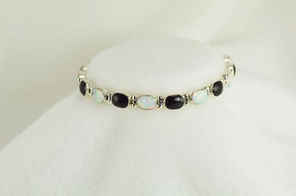 "Sterling silver black onyx and white opal oval 7.5"" link bracelet. B029"