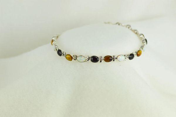 "Sterling silver multi color opal, black onyx and tiger eye oval 7.5"" bracelet. B035"