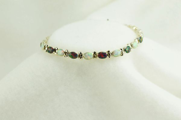 "Sterling silver black and white opal 7.75"" link bracelet. B065"