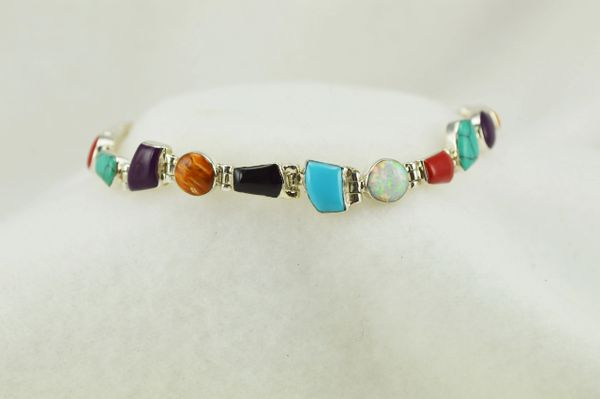 "Sterling silver multi color multi shape link 8"" bracelet. B100"