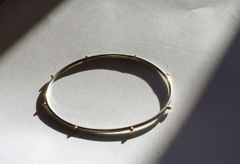 Sterling silver and solid gold bangle
