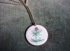 Enamelled thistle pendant with solid sterling silver chain.