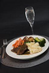 ROAST LAMB DINNER WITH MINT GRAVY