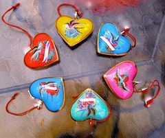 Heart ornaments with birds and flowers