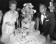 Candid of Lucille Ball and Desi Arnaz Blowing Out The Candles to their Anniversary Cake 8x10