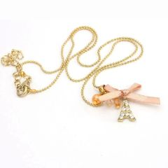 Golden Eiffel Tower Necklace Charm With Pale Pink Bow