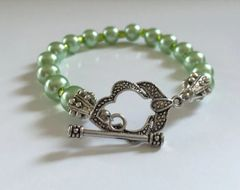 "Beautiful 8.5"" Hand Made Mint Green Round Imitation Pearl Bracelet With Ornate Toggle Bar Clasp Assembly"