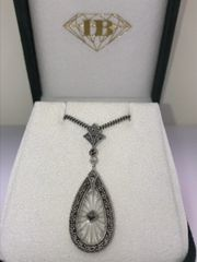 STERLING SILVER SUNRAY CRYSTAL AND MARCASITE PENDANT