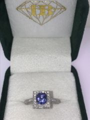 14K WHITE GOLD TANZANITE RING ROUND WITH A HALO DESIGN