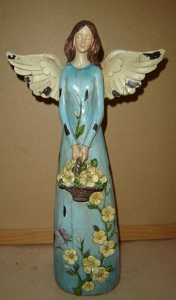 Garden angel figurine in blue dress with basket of flowers