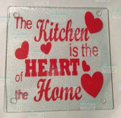 The Kitchen is the Heart of the Home cutting board with hearts design