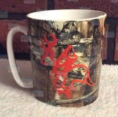 Sportsman Fleur de lis Mossy Oak Camoflage coffee cup with Buck, Fish and Duck