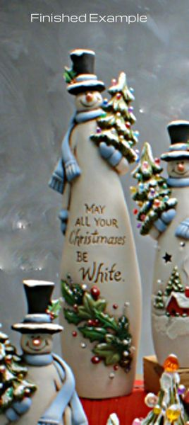 Tall Snowman Holding Christmas Tree