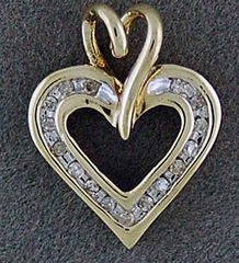 A Ladies Diamond and Gold Heart Pendant