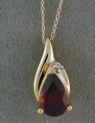 Tear Drop Garnet and Diamond Pendant on a Fine Chain