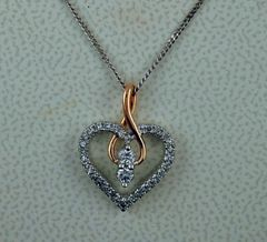 1/4ctw Two-Tone Heart Pendant on a Fine Box-Link Chain