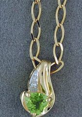 Peridot and DIamond Chip Pendant on a Circle Link Chain
