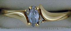 Ladies Twist Style Purple Stone and Diamond Ring