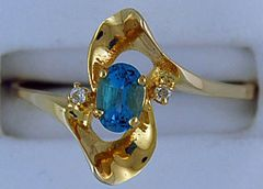 Ladies Blue Topaz and Diamond Ring
