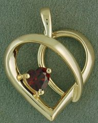 Free Form Heart Pendant with a Heart Cut Garnet