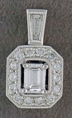 1/3ctw Emerald and Round Cut Diamond Pendant