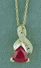 Red Stone and Diamond Pendant on a Chain