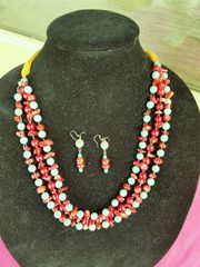 Red coral and turquoise magnesite multi-strand necklace with leather tie offs