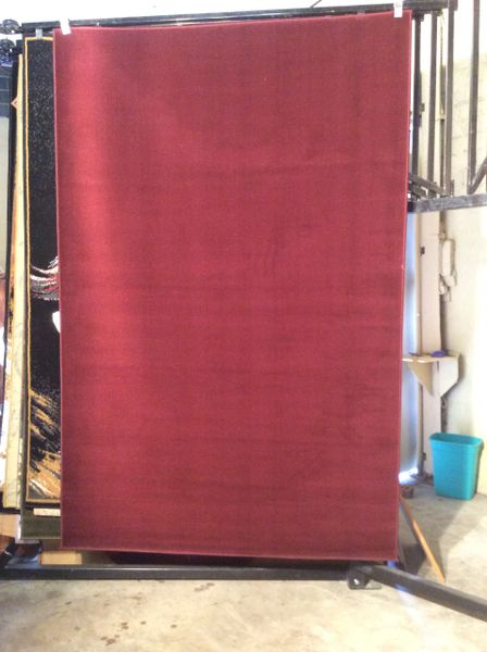 Solid cranberry 5x8 machine-made rug.sold out