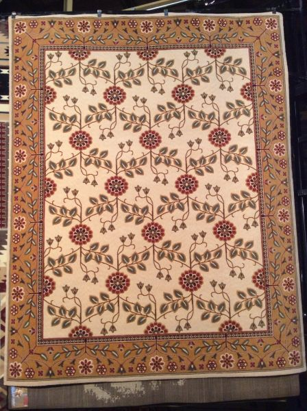 Creme and neutral toned floral pattern 8x11 machine-made rug.sold out