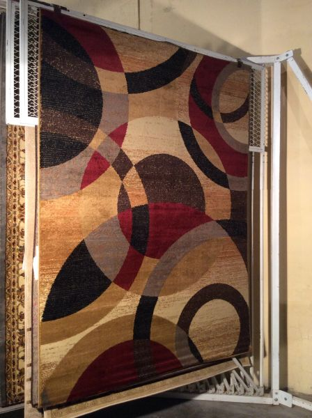 Contemporary multi-colored 5x8 machine-made rug
