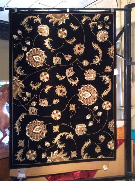 Black magnolia design machine-made rug