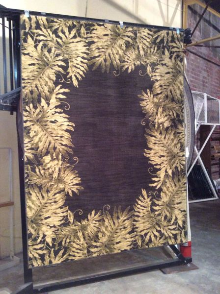 Tommy Bahama palm tree 5x8 machine-made rug.sold out