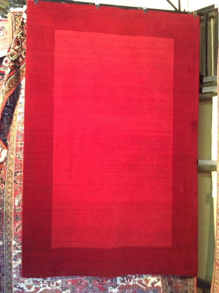 Solid red Hand Hooked 5x8 wool rug