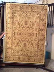 Creme all over persian pattern 5x8 machine-made rug.sold out