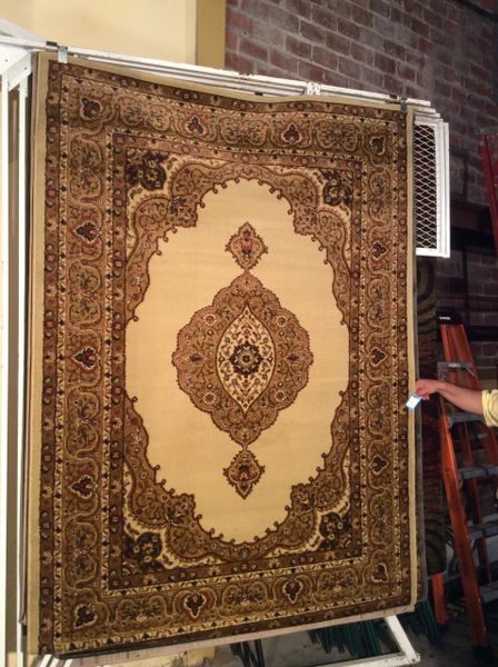 Creme open-field persian design 5x8 machine-made rug