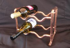 Copper wine bottle rack to hold six bottles