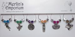 Down the rabbit hole wine glass charm set