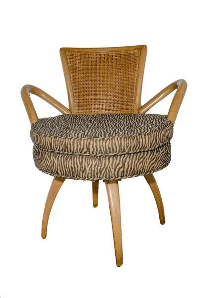 Mid-Century Cane Back Swivel Chair with Tiger Print Cushion. Drama and Simplicity!