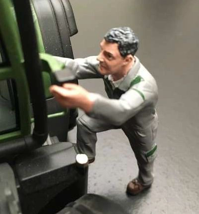 AT COLLECTIONS 1:32 SCALE FARMER GETTING INTO TRACTOR
