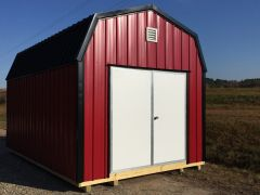 Used 10x16 Amish Metal Red w/ Black Roof
