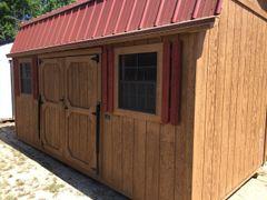 Used 12x16 Cedar w/ Red Roof