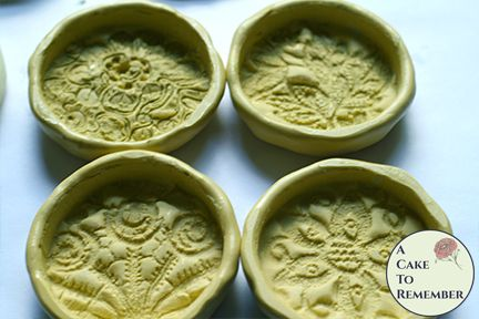 Set of four solid lotion bar molds with lace flower patterns