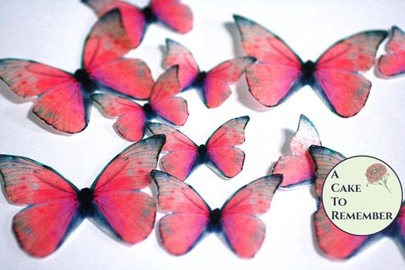 12 red wafer paper edible butterflies for wedding cake toppers.